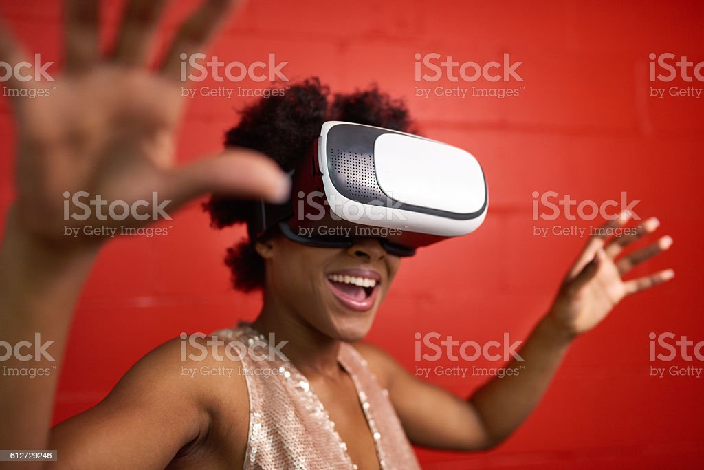 Cool millennial black woman exploring space with virtual reality glasses stock photo