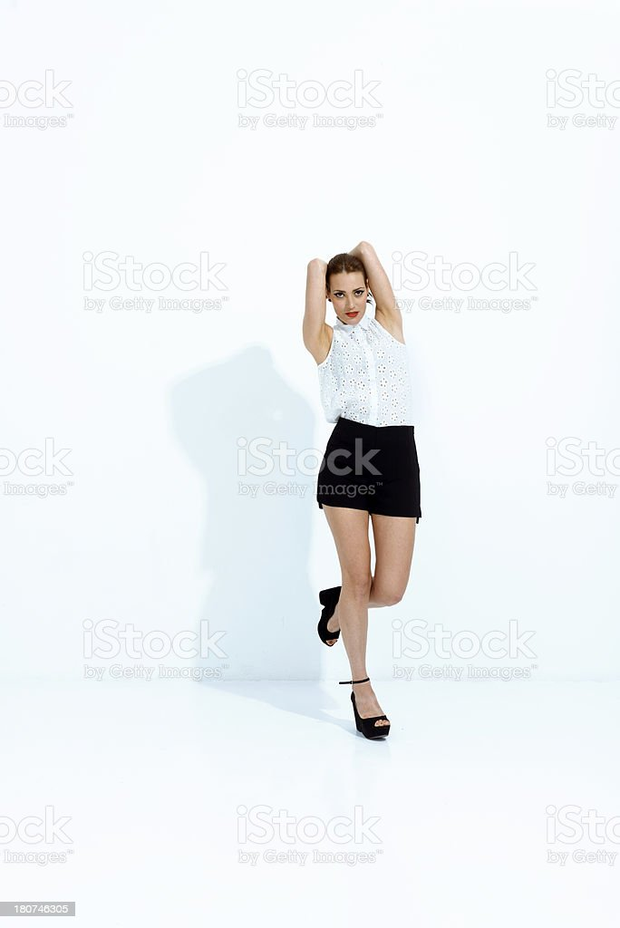 Cool model posing in a white space royalty-free stock photo