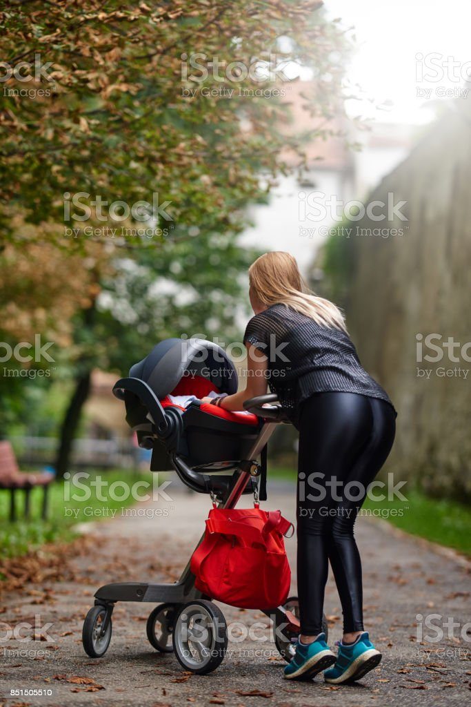 cool mother walking in the city stock photo