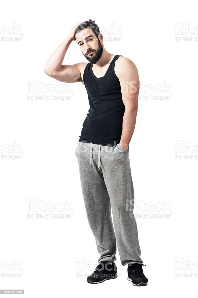 Cool relaxed athlete in singlet with hands running through hair. stock photo