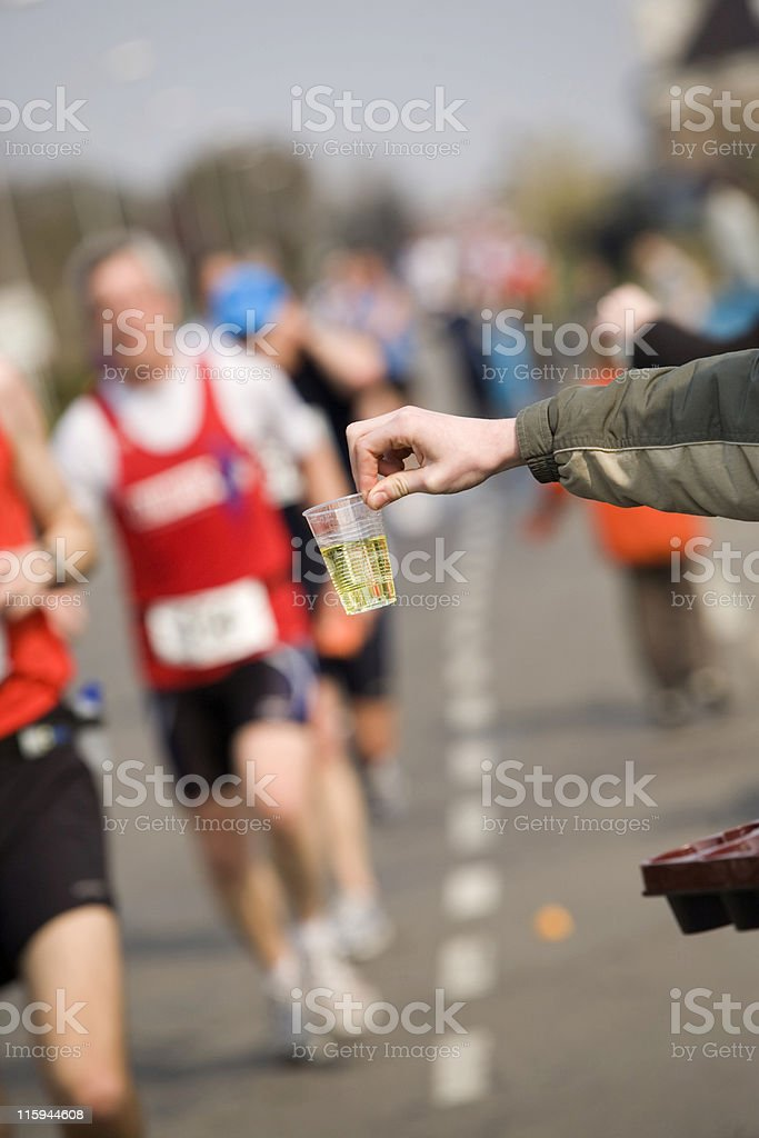 cool sport drink offered to runners at a marathon royalty-free stock photo