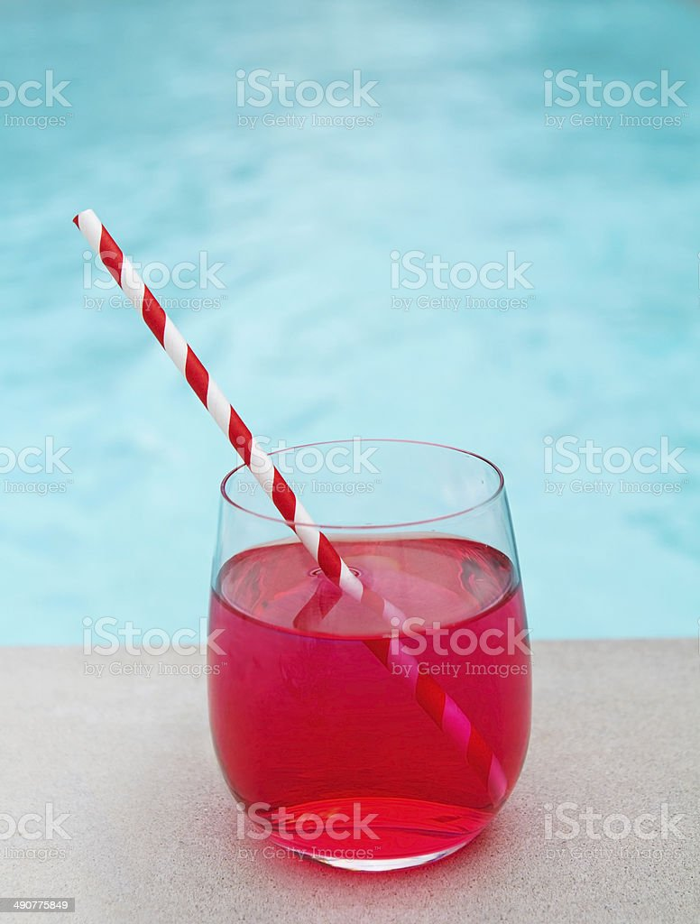 Cool summer cocktail by the pool stripe straw stock photo