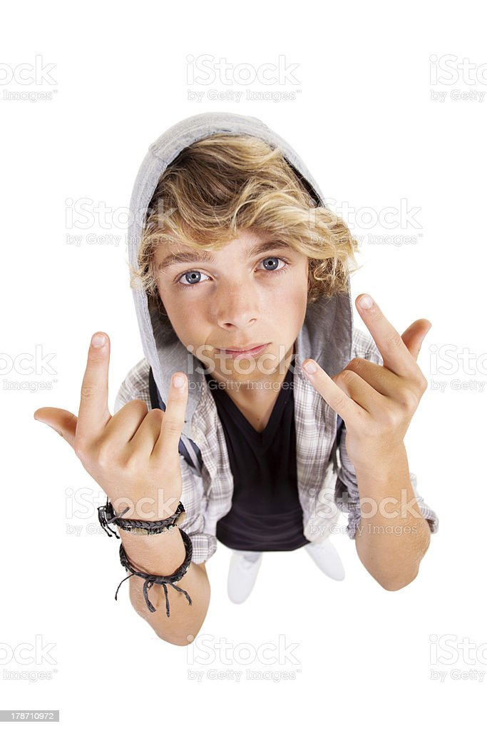 cool teen boy giving hand sign royalty-free stock photo
