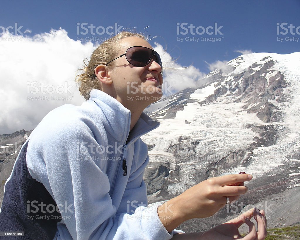 Cool teenager against mount Rainier royalty-free stock photo