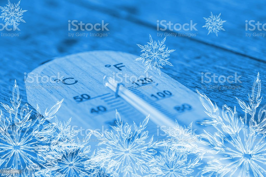 cool thermometer, ice frost snowflake temperature freeze day concept. stock photo