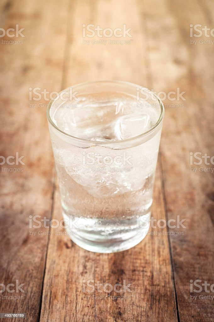 Cool water drink in glass on wooden stock photo