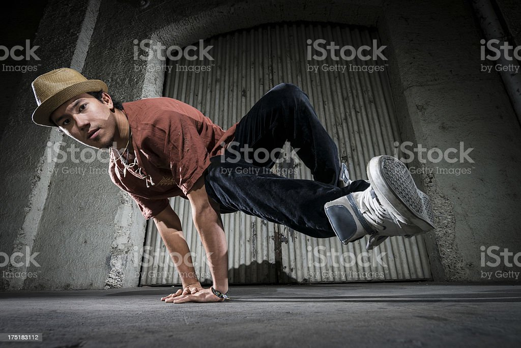 cool young asian man dancing in the street stock photo