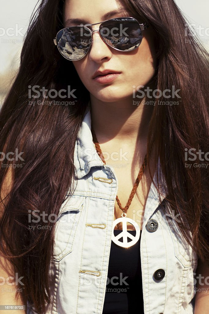 Cool young girl in sunglasses royalty-free stock photo