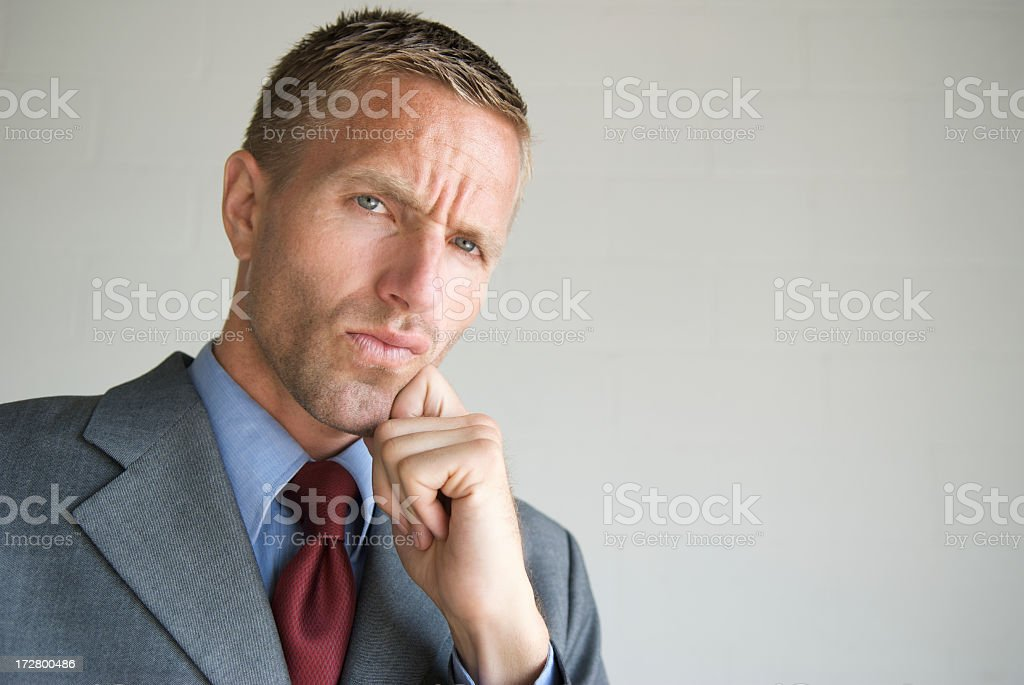 Cool Young Man Businessman Thinking with Hand on Chin stock photo