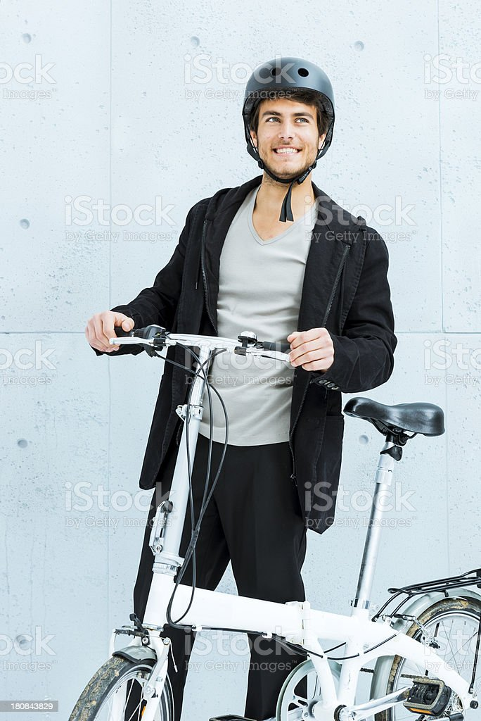 Cool young man with foldable bicycle stock photo
