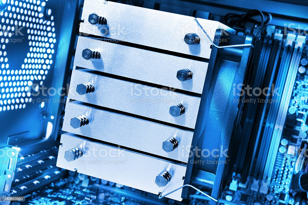 CPU cooler on motherboard royalty-free stock photo
