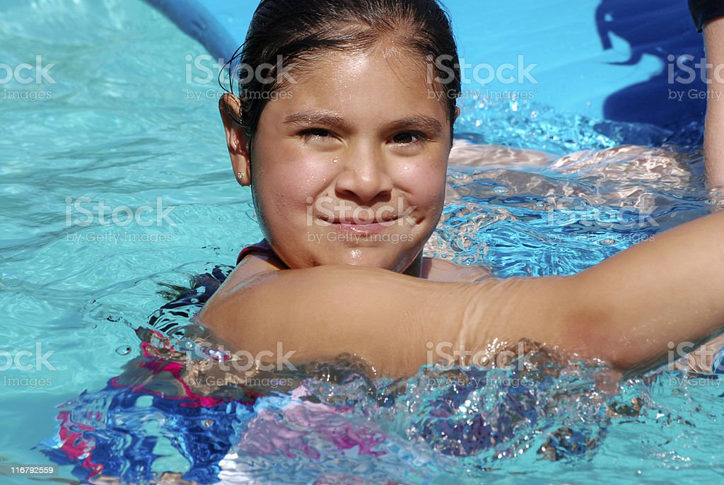 Cooling off in a pool royalty-free stock photo