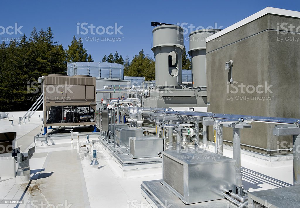 Cooling Tower, Air Ducts, and Associated Plumbing for HVAC System stock photo