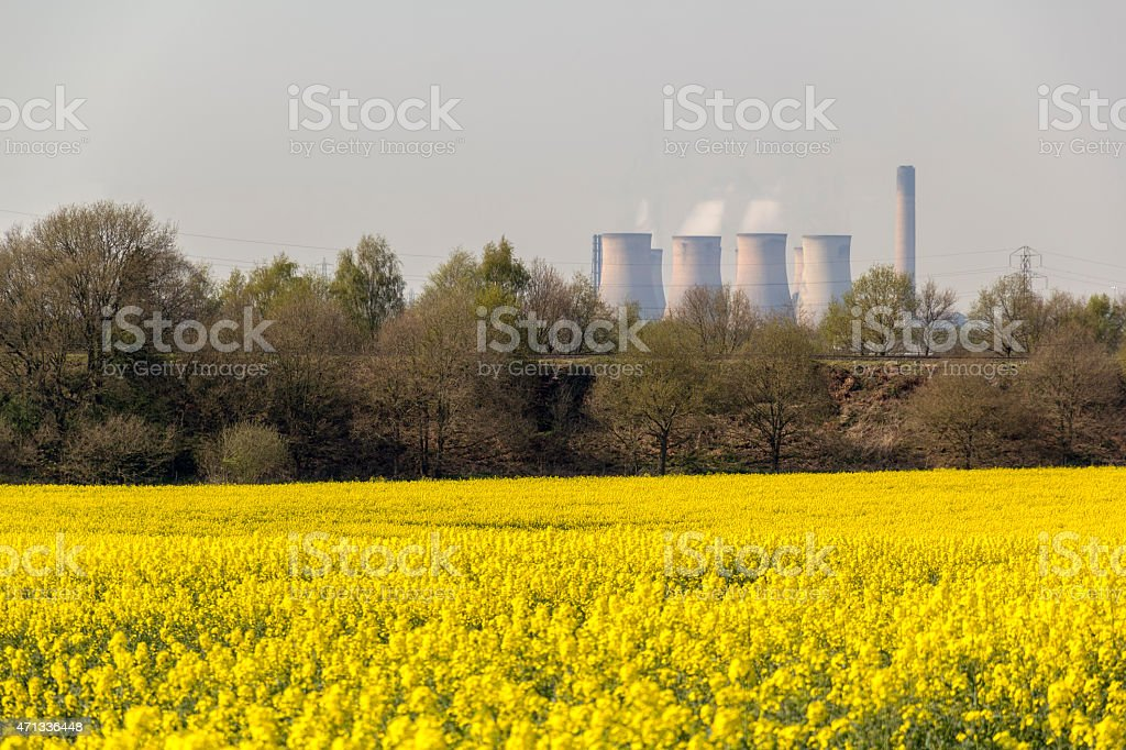 Cooling Towers Above Oil Seed Rape Field stock photo
