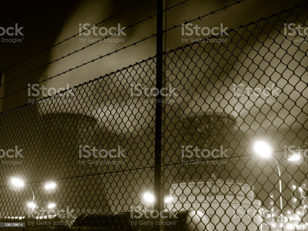 Cooling Towers Behind Fence at Night royalty-free stock photo