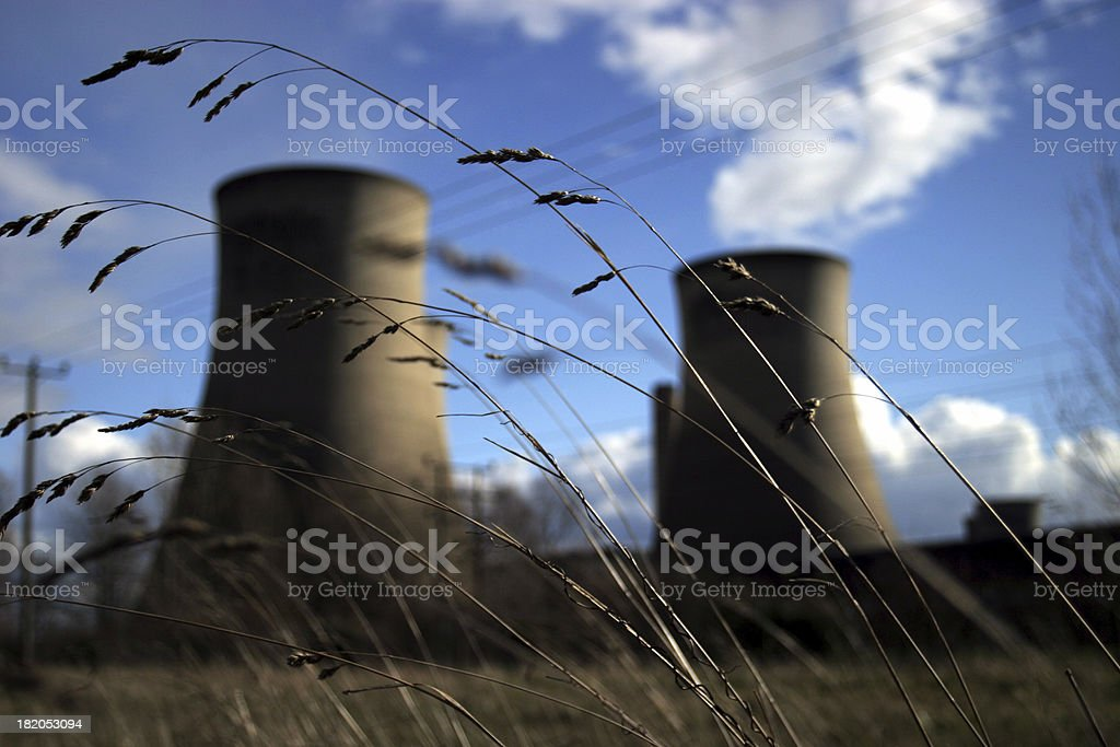 Cooling towers behind straw royalty-free stock photo