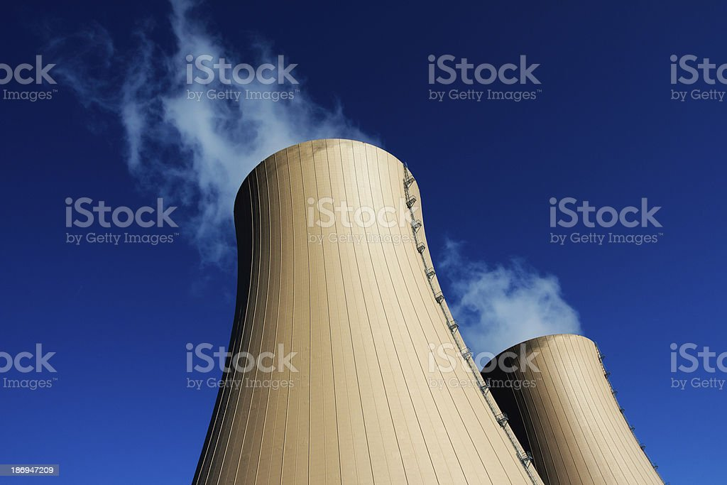 Cooling towers of nuclear power plant against  blue sky stock photo