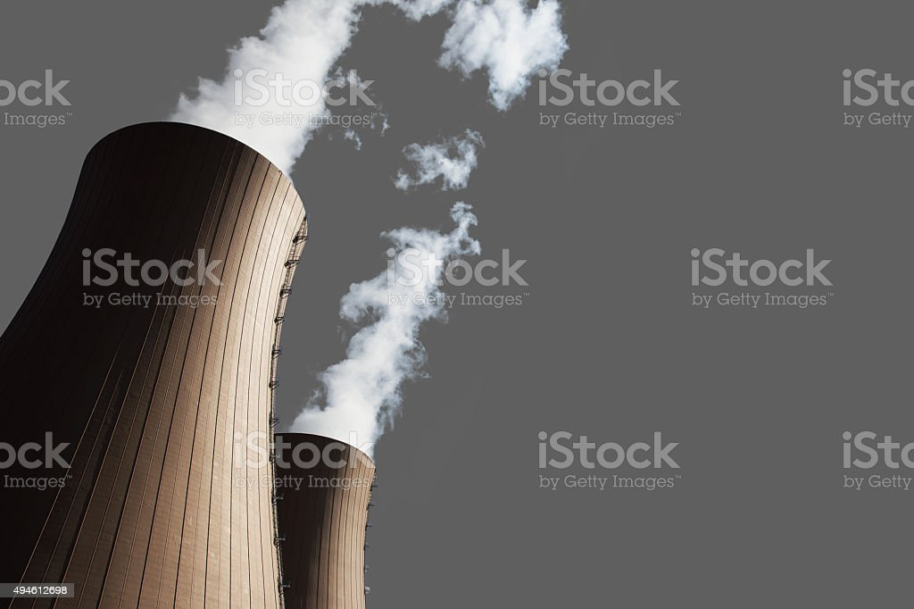 Cooling towers of nuclear power plant on gray backgrond stock photo