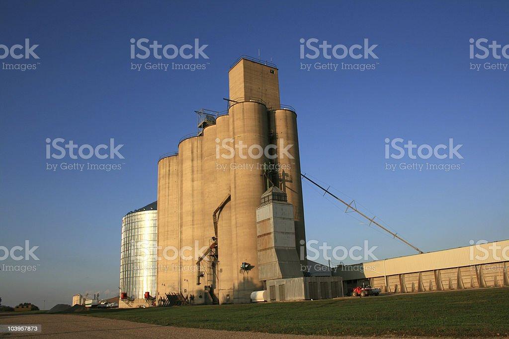 Co-op grain tower in rural Iowa stock photo