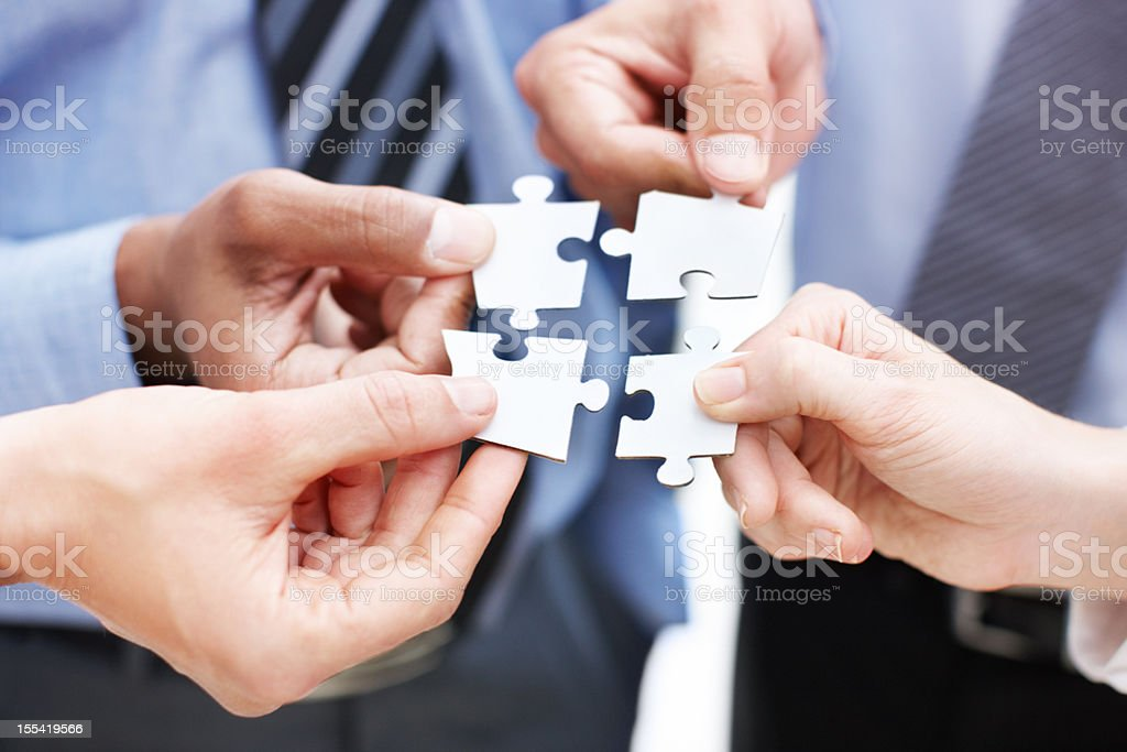 Cooperation is the strategic solution - Business Teamwork/Unity royalty-free stock photo