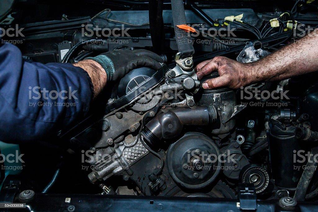cooperation on repairing motors stock photo