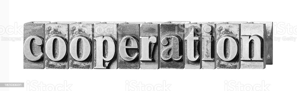 Cooperation written in metal printing press letters royalty-free stock photo