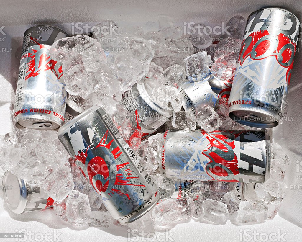 Coors Light in a cooler full of ice stock photo