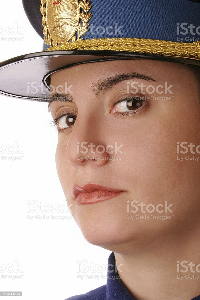 Cop female watching you with police cap stock photo