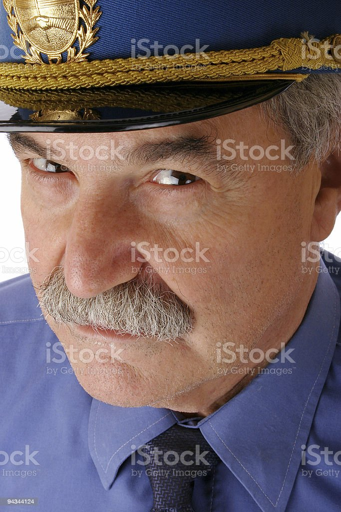 Cop looking sceptical stock photo