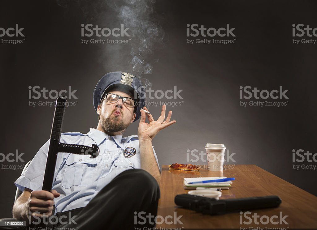 Cop on Break holding his Billy Club in Jest royalty-free stock photo
