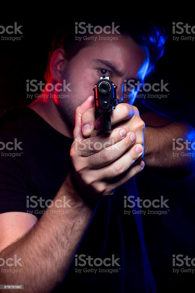 Cop or Criminal Holding a Gun stock photo