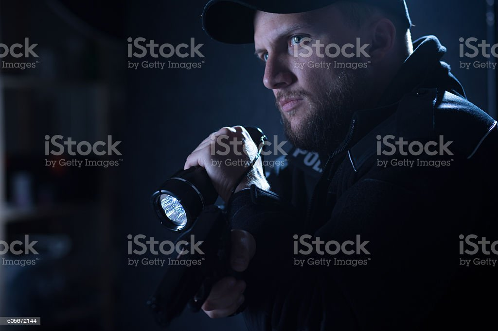 Cop pointing pistol stock photo