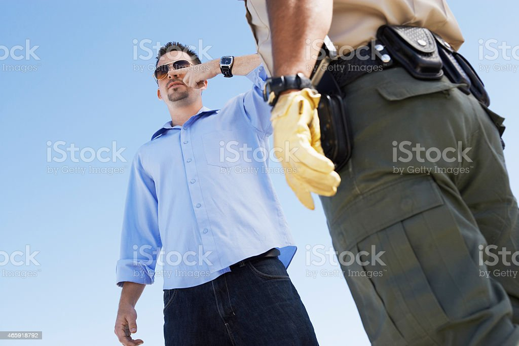 Cop Suspecting a Man of Drunk Driving stock photo