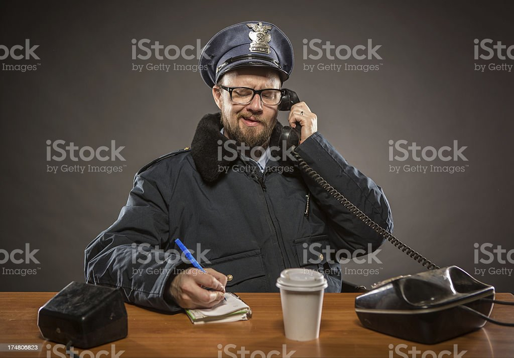 Cop talking on the Phone royalty-free stock photo