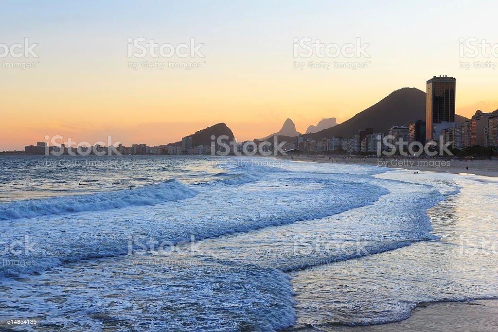 Copacabana beach, mountain Vidigal, Pedra da Gavea, sea in sunse stock photo