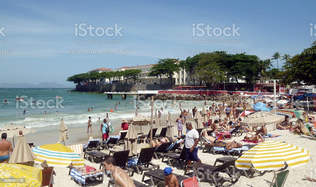 Copacabana Beach with bathers and stand up paddlers stock photo