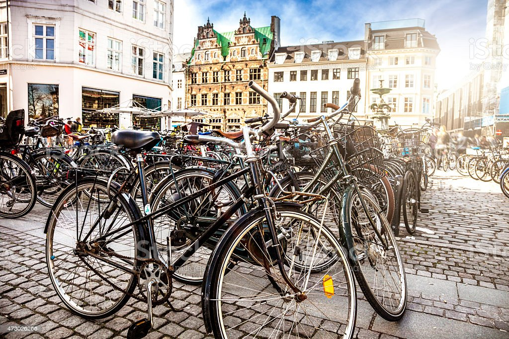 Copenhagen bycicle parked in a town square stock photo