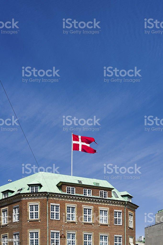 Copenhagen: Danish flag atop a building royalty-free stock photo