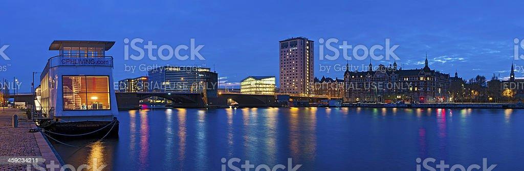 Copenhagen houseboats harbour highrises illuminated night panorama Denmark stock photo