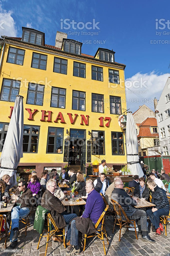 Copenhagen Nyhavn crowded cafes colourful waterfront Denmark royalty-free stock photo