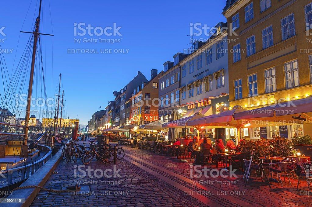Copenhagen Nyhavn restaurants illuminated at dusk Denmark royalty-free stock photo