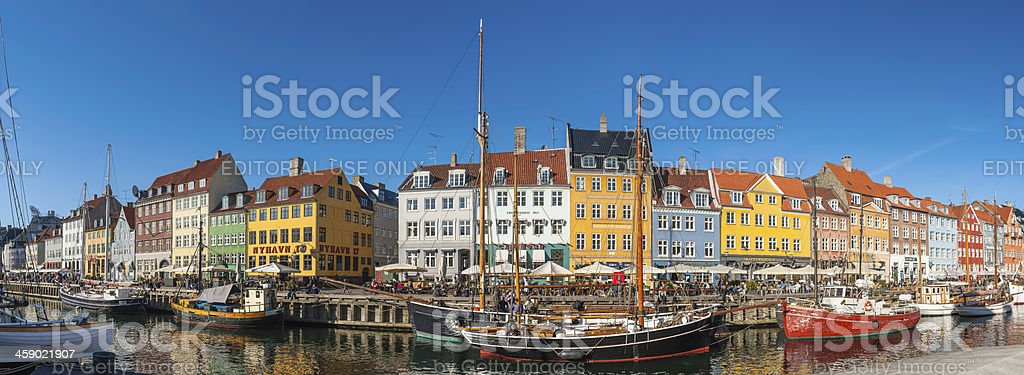 Copenhagen Nyhavn vibrant waterfront crowds colourful bars panorama Denmark royalty-free stock photo