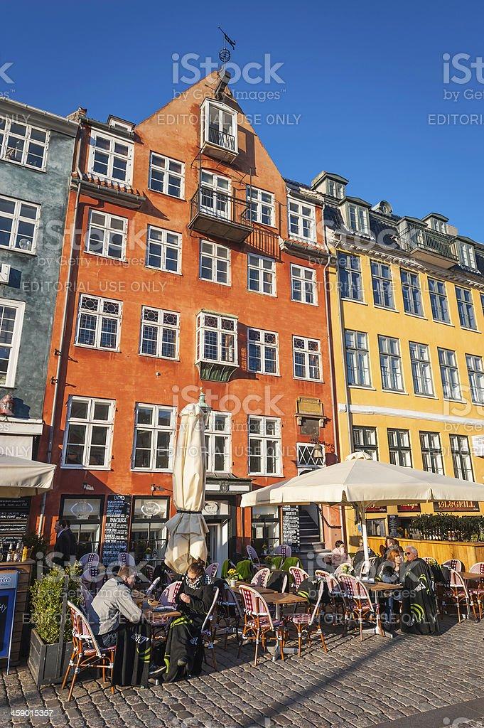 Copenhagen people at outdoor cafe bars Nyhavn Denmark royalty-free stock photo