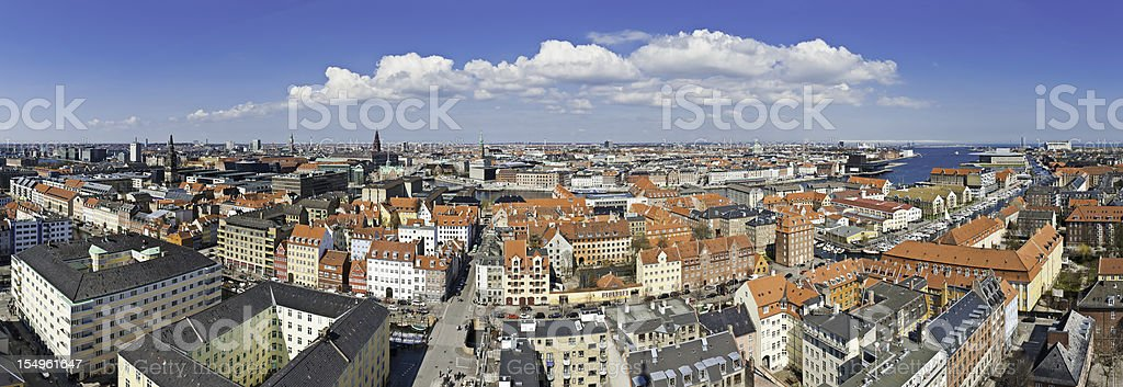 Copenhagen rooftop panorama city landmarks spires homes Christianshavns Denmark stock photo