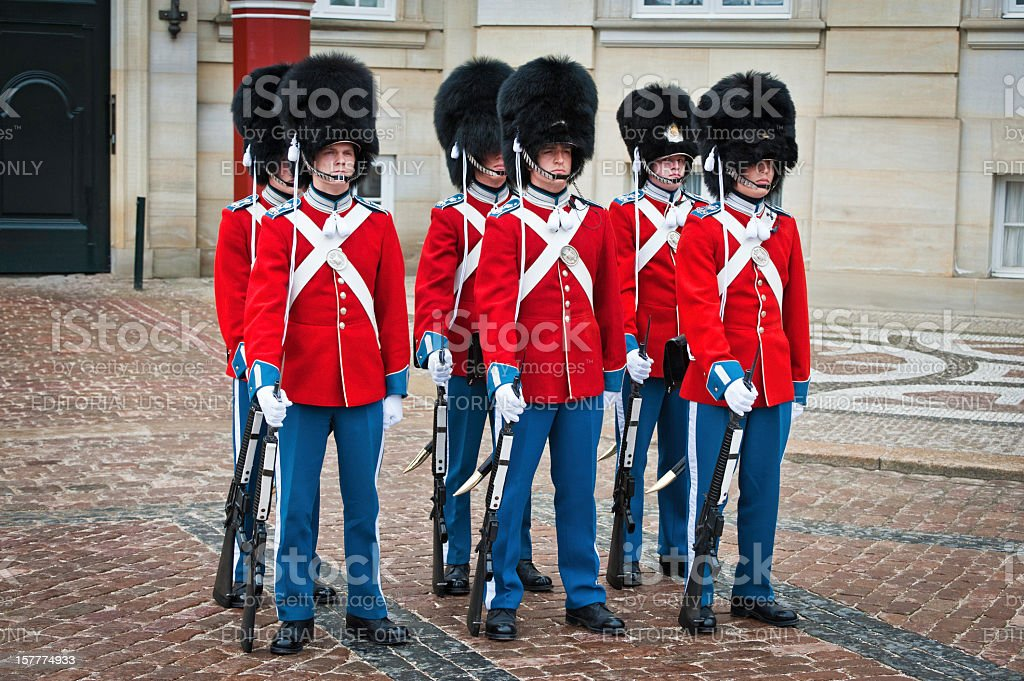 Copenhagen soldiers colourful uniforms Amalienborg Denmark stock photo