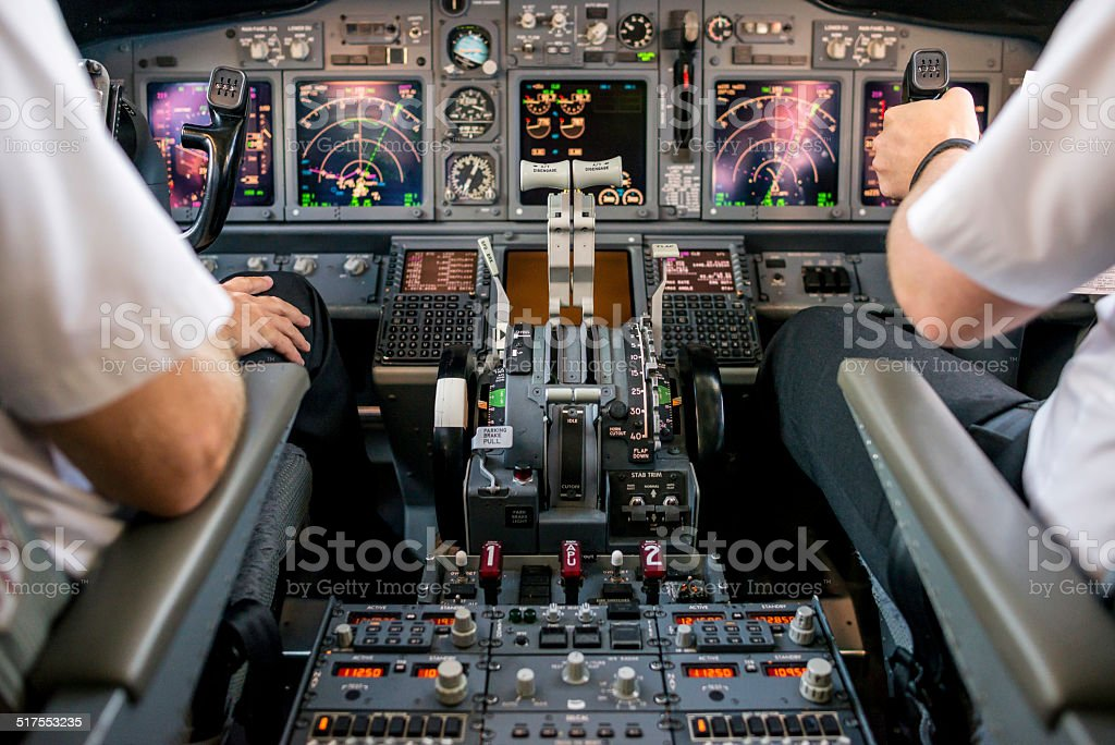 Co-pilot flying an aircraft stock photo