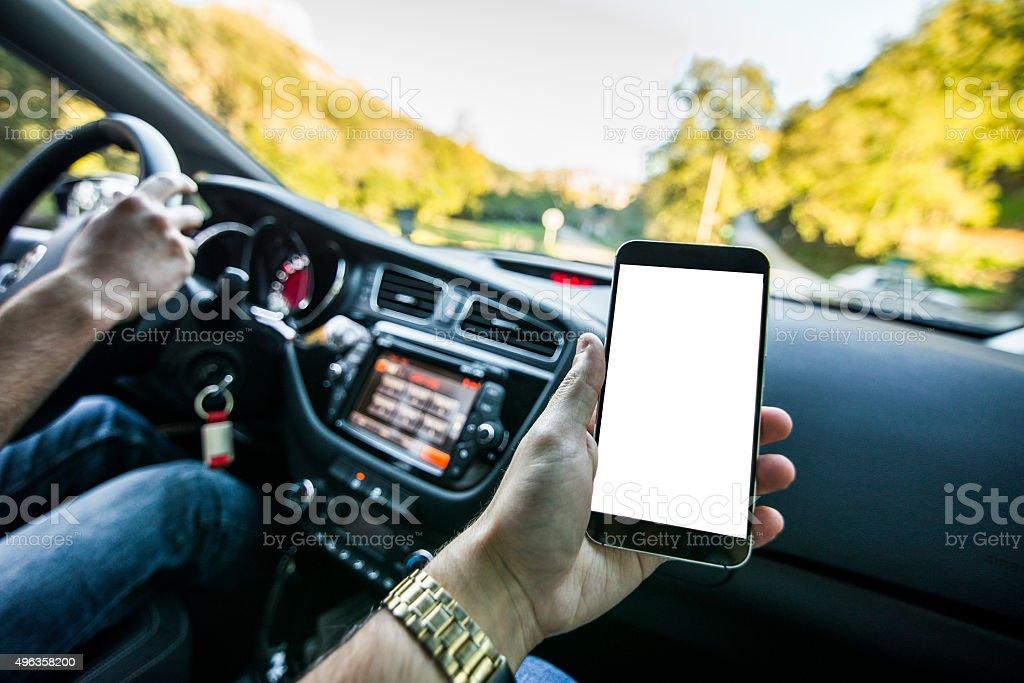 Copilot using mobile phone stock photo