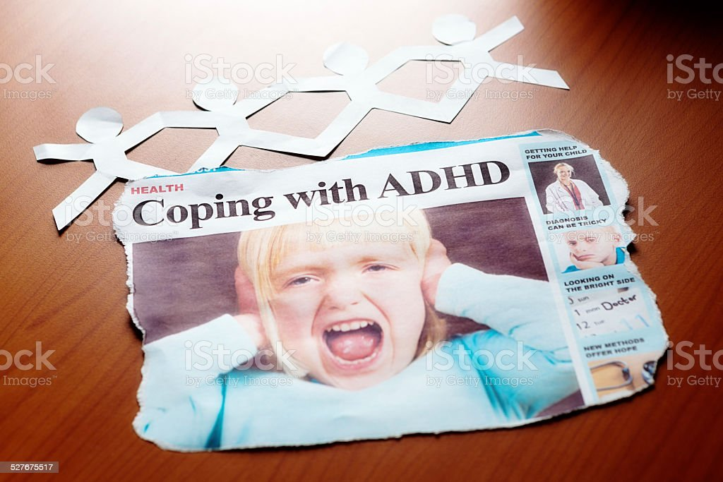 'Coping with ADHD' headline shows screaming little girl stock photo