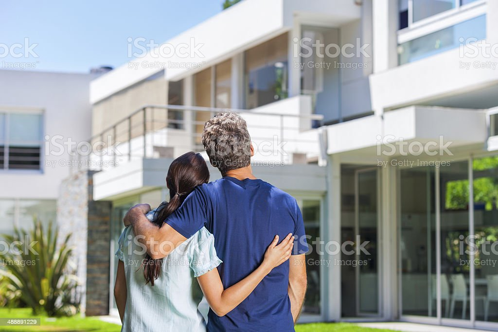 Cople family looking to new modern big house stock photo