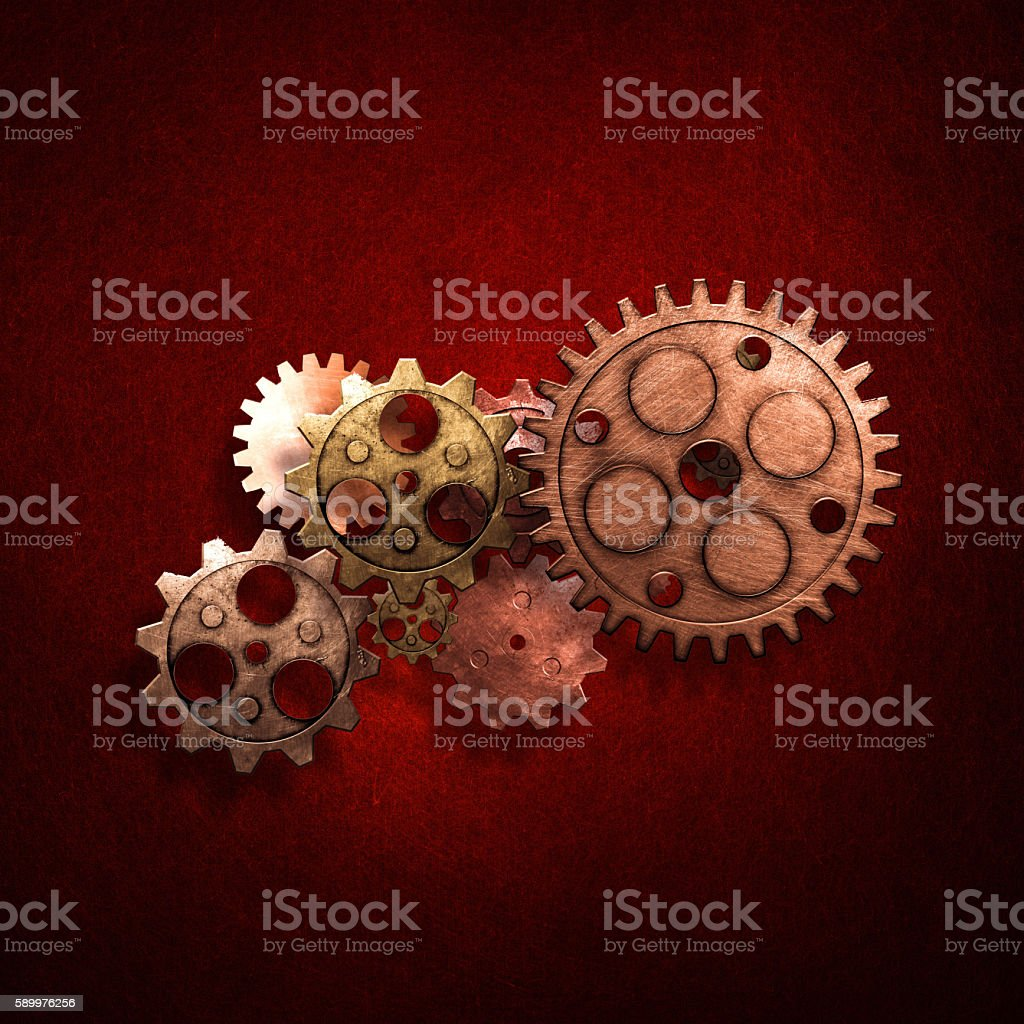 copper and brass gear on the gold metallic wall. stock photo